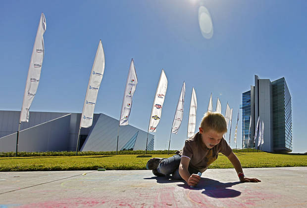 Chris Bachman, 7, works on sidewalk chalk art during the Oklahoma Regatta Festival at the Oklahoma River on Saturday, Oct. 1, 2011, in Oklahoma City, Okla. Photo by Chris Landsberger, The Oklahoman