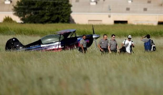 Oklahoma City Police respond to a plane that made an emergency landing in an empty field near 150th Street and North Kelly, Tuesday, July 20, 2010, in Oklahoma City. Photo by  Sarah  Phipps, The Oklahoman. 