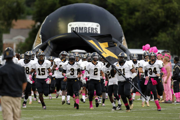 Midwest City Bombers take the field to play the Del City Eagles in high school football on Friday, Sept. 20, 2013 in Del City, Okla.  Photo by Steve Sisney, The Oklahoman
