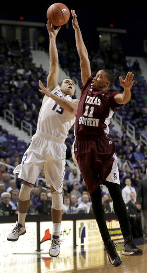 Kansas State guard Angel Rodriguez (13) passes the ball under pressure from Texas Southern guard Lawrence Johnson-Danner (11) during the first half of an NCAA college basketball game Tuesday, Dec. 18, 2012, in Manhattan, Kan. (AP Photo/Charlie Riedel)