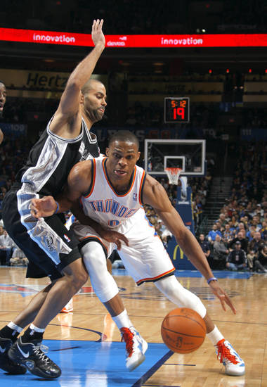 Oklahoma City Thunder's Russell Westbrook (0) tries to get by San Antonio Spurs' Tony Parker (9) during the the NBA basketball game between the Oklahoma City Thunder and the San Antonio Spurs at the Chesapeake Energy Arena in Oklahoma City, Sunday, Jan. 8, 2012. Photo by Sarah Phipps, The Oklahoman
