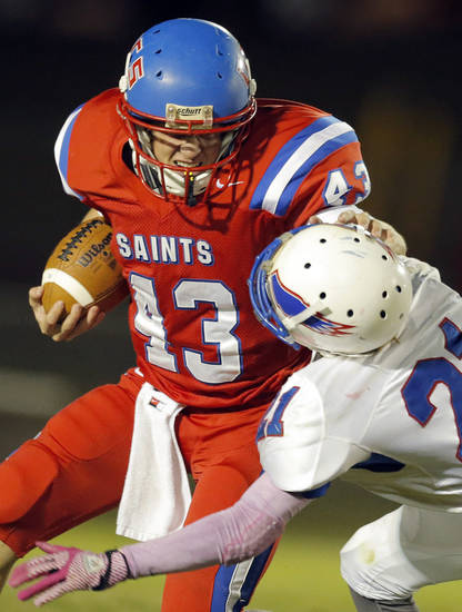 OCS' Cameron James tries to get by Millwood's Janari Glover during the high school football game between Oklahoma Christian and Millwood at Oklahoma Christian Schools in Edmond, Okla.,  Friday, Oct. 5, 2012. Photo by Sarah Phipps, The Oklahoman