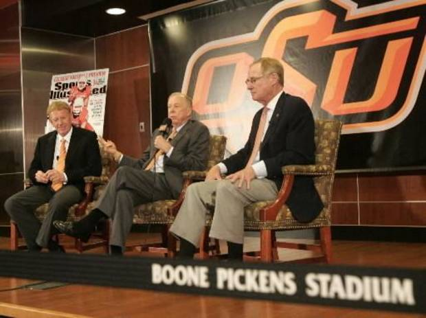 Oklahoma State University athletic director Mike Holder, left and OSU President Burns Hargis, right listen to T. Boone  Pickens, center after taking a tour of the west end zone of Boone  Pickens Stadium's facilities in Stillwater, Oklahoma August 17, 2009. Photo by Steve Gooch