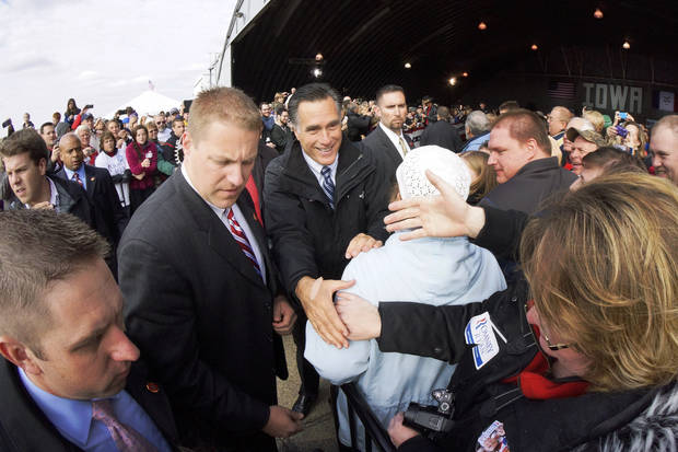 In this image made with a fisheye lens, Republican presidential candidate and former Massachusetts Gov. Mitt Romney greets supporters as he campaigns at Dubuque Regional Airport, in Dubuque, Iowa, Saturday, Nov. 3, 2012. (AP Photo/Charles Dharapak)