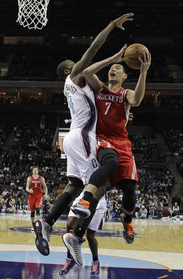 Houston Rockets' Jeremy Lin (7) is fouled as he drives to the basket against Charlotte Bobcats' Michael Kidd-Gilchrist (14) during the first half of an NBA basketball game in Charlotte, N.C., Monday, Jan. 21, 2013. (AP Photo/Chuck Burton)