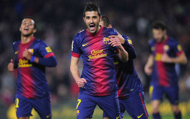 FC Barcelona's David Villa reacts after scoring against Cordoba during a Copa del Rey soccer match at the Camp Nou stadium in Barcelona, Spain, Thursday, Jan. 10, 2013. (AP Photo/Manu Fernandez)