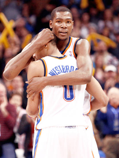 Kevin Durant and Russell Westbrook celebrate a win over the Jazz. Durant was a little late filling out his NCAA bracket.  Photo by Sarah Phipps, The Oklahoman