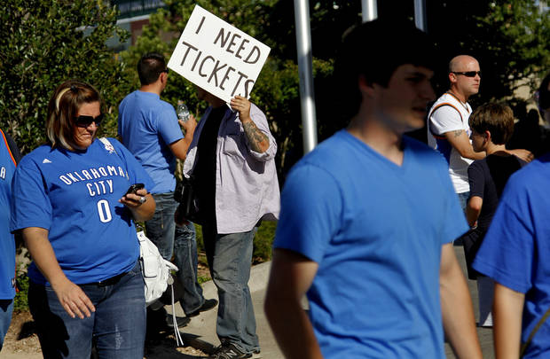 A Thunder fan tries to get last minute tickets before game 3 of the Western Conference Finals of the NBA basketball playoffs between the Dallas Mavericks and the Oklahoma City Thunder at the OKC Arena in downtown Oklahoma City, Saturday, May 21, 2011. Photo by Chris Landsberger, The Oklahoman