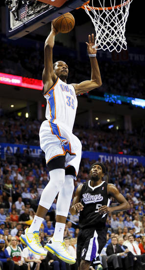 Oklahoma City's Kevin Durant (35) dunks in front of Sacramento's John Salmons (5) during an NBA basketball game between the Oklahoma City Thunder and the Sacramento Kings at Chesapeake Energy Arena in Oklahoma City, Monday, April 15, 2013. Photo by Nate Billings, The Oklahoman