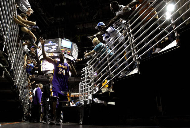 Fans greet Los Angeles Lakers shooting guard Kobe Bryant (24) as he walks off the court after an NBA basketball game against the New Orleans Hornets in New Orleans, Wednesday, Dec. 5, 2012. Bryant became the youngest player in NBA history to surpass 30,000 points. The Lakers won 103-87. (AP Photo/Gerald Herbert) ORG XMIT: LAGH107