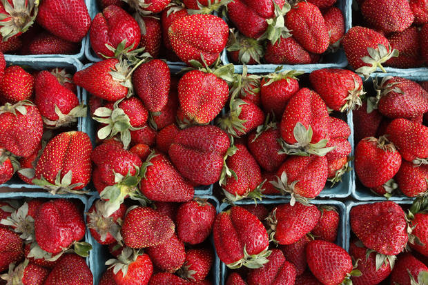 Strawberries from the Urban Agrarian are local, like all the rest of the market's food products. <strong>DOUG HOKE - THE OKLAHOMAN</strong>