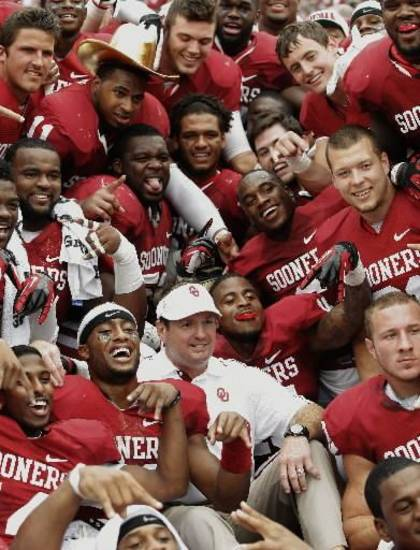 The OU team, including coach Bob Stoops pose for a team photo after the Red River Rivalry college football game between the University of Oklahoma (OU) and the University of Texas (UT) at the Cotton Bowl in Dallas, Saturday, Oct. 13, 2012. Oklahoma won 63-21. Photo by Bryan Terry, The Oklahoman