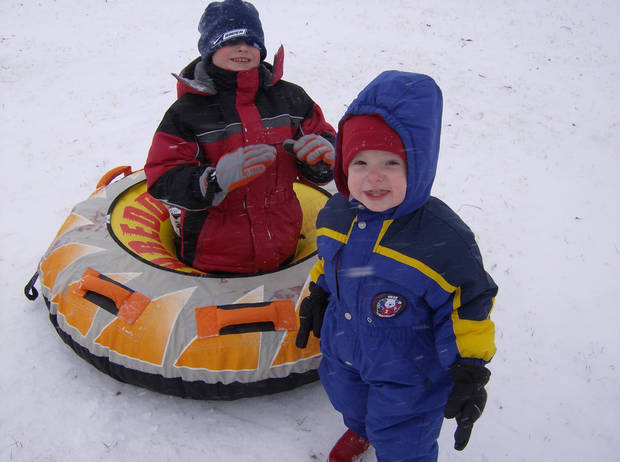 Christopher showing little brother Ethan how to enjoy the snow!<br/><b>Community Photo By:</b> Michel Littlefield<br/><b>Submitted By:</b> Michel, Tinker AFB