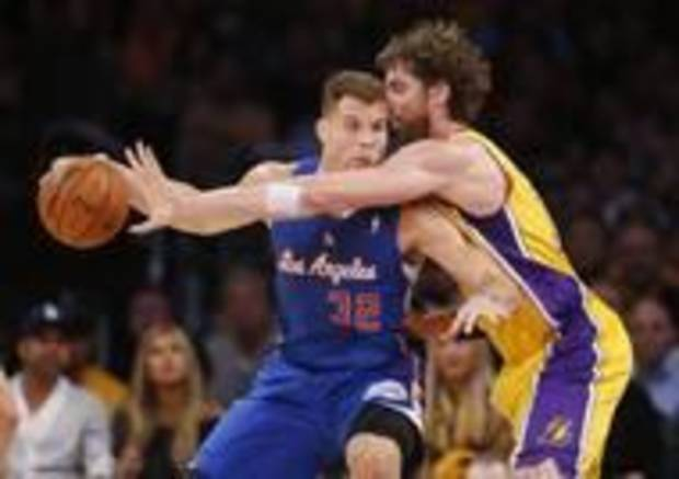 Pau Gasol (right) defenders against the Clippers' Blake Griffin in a Laker game last October. (AP Photo)