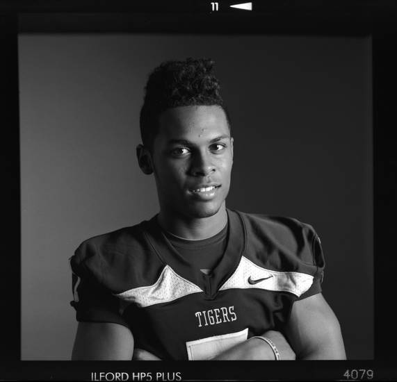 All-State high school football player Cre Moore of Broken Arrow poses for a photo in Oklahoma City,  Monday, Dec. 17, 2012. Photo by Nate Billings, The Oklahoman