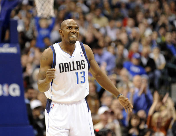 Dallas Mavericks guard Mike James celebrates after a basket in the fourth quarter of an NBA basketball game against the Oklahoma City Thunder, Friday, Jan. 18, 2013, in Dallas. (AP Photo/Matt Strasen)