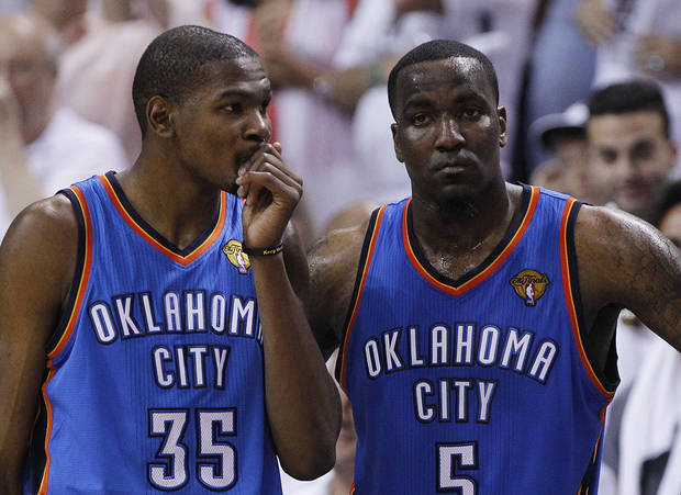 Oklahoma City Thunder small forward Kevin Durant (35) and center Kendrick Perkins (5) react against the Miami Heat during the second half at Game 3 of the NBA Finals basketball series, Sunday, June 17, 2012, in Miami. Miami won 91-85. (AP Photo/Lynne Sladky) ORG XMIT: NBA154