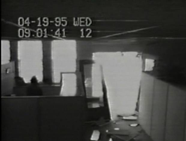 A Southwestern Bell security camera shows damage to an entrance of the communication company's building after the explosion. The time on the recording is slightly behind the established time of the bombing.