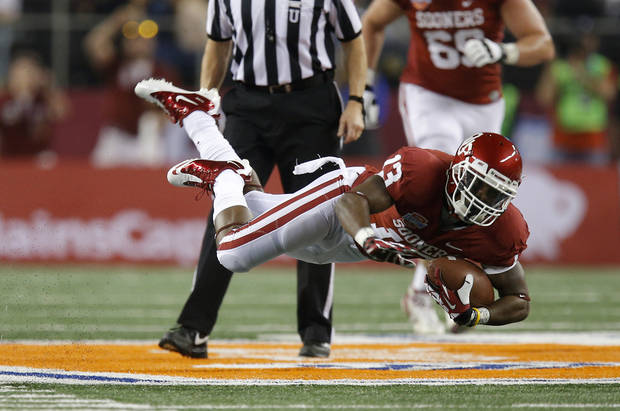 Oklahoma's Durron Neal (13) leaps during the Cotton Bowl college football game between the University of Oklahoma (OU)and Texas A&M University at Cowboys Stadium in Arlington, Texas, Friday, Jan. 4, 2013. Oklahoma lost 41-13. Photo by Bryan Terry, The Oklahoman