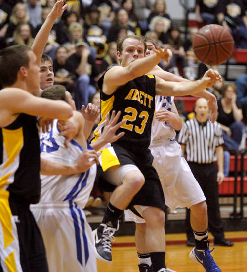 Arnett's Jason Johnson passes the ball beside Fargo's Sam Baker, left, and Derek Harrington in first round of the Class B state basketball tournament at Carl Albert in Midwest City, Thursday, March 1, 2012. Photo by Bryan Terry, The Oklahoman