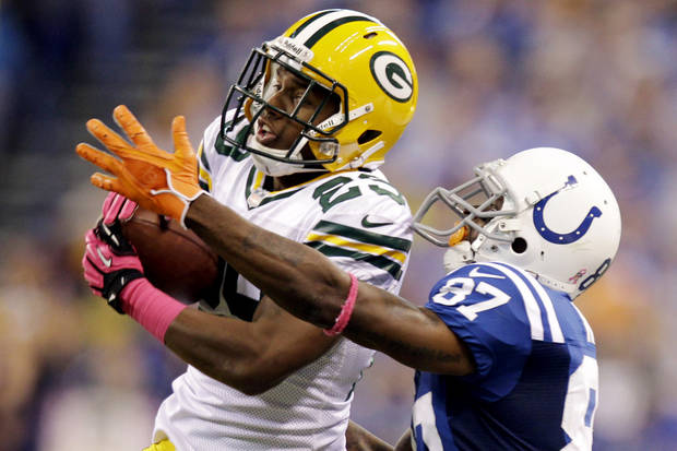Green Bay Packers cornerback Casey Hayward (29) intercepts a pass intended for Indianapolis Colts wide receiver Reggie Wayne during the second half of an NFL football game in Indianapolis, Sunday, Oct. 7, 2012. (AP Photo/Michael Conroy)