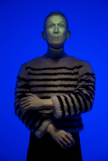 "A animated mannequin representing French fashion designer Jean Paul Gaultier is seen during the opening of the exhibit ""The Fashion World of Jean Paul Gaultier, from the sidewalk to the catwalk"", at Kunsthal museum in Rotterdam, Netherlands, Friday Feb. 8, 2013. The exhibit open Feb. 10, 2013. (AP Photo/Peter Dejong)"