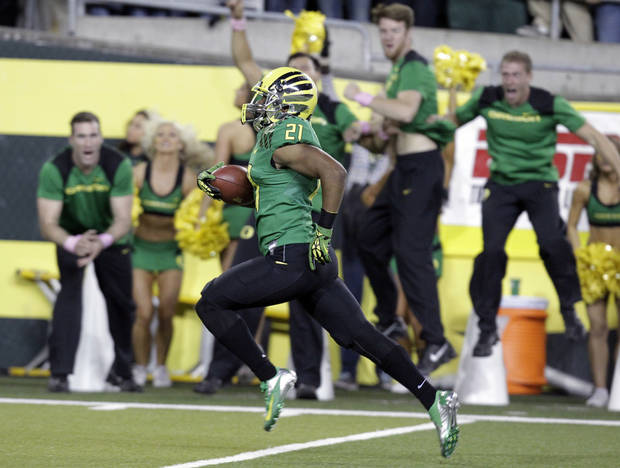 Oregon defender Avery Patterson runs for a touchdown after intercepting a pass during the first half of an NCAA college football game against Washington in Eugene, Ore., Saturday, Oct. 6, 2012. (AP Photo/Don Ryan)