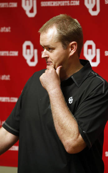 Sooner co-offensive coordinator Josh Heupel speaks with the media at the University of Oklahoma on Saturday, Aug. 4, 2012, in Norman, Okla.  Photo by Steve Sisney, The Oklahoman