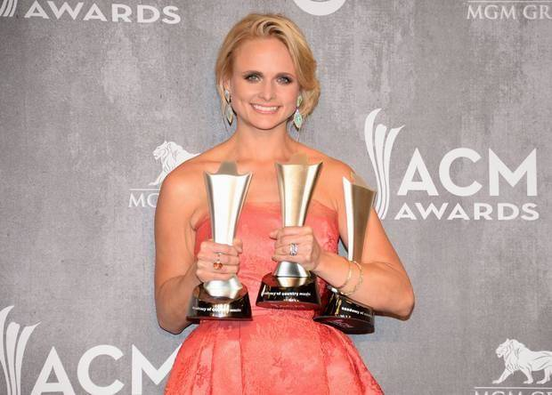 Miranda Lambert poses in the press room with the awards for vocal event of the year, female vocalist of the year and single record of the year at the 49th annual Academy of Country Music Awards at the MGM Grand Garden Arena on Sunday, April 6, 2014, in Las Vegas. (AP)