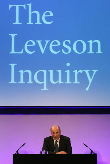 Britain&#039;s Lord Justice Brian Leveson delivers a statement following the release of the Leveson Inquiry report at the Queen Elizabeth II Centre, London, Thursday, Nov. 29, 2012. After a yearlong inquiry full of sensational testimony, Lord Justice Leveson released his report Thursday into the culture and practices of the British press and his recommendations for future regulation to prevent phone hacking, data theft, bribery and other abuses. (AP Photo/Dan Kitwood, Pool)