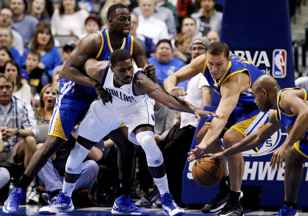 Dallas Mavericks center Bernard James (5) fights for a rebound against Golden State Warriors' Draymond Green, top left, Andris Biedrins, second from right, and Jarrett Jack in the first half of an NBA basketball game, Monday, Nov. 19, 2012, in Dallas. (AP Photo/Tony Gutierrez)