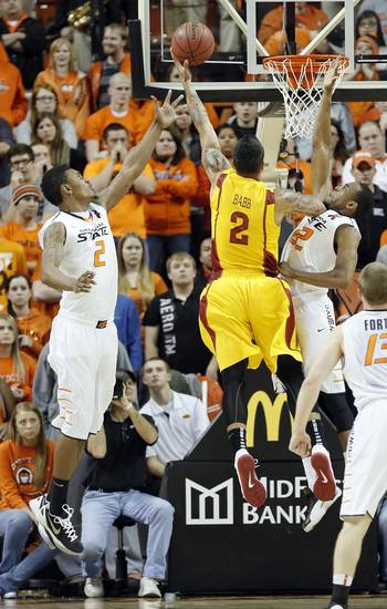 Oklahoma State Cowboys' Le'Bryan Nash (2) and Markel Brown (22) defend on Iowa State Cyclones' Chris Babb (2) during the college basketball game between the Oklahoma State University Cowboys (OSU) and the Iowa State University Cyclones (ISU) at Gallagher-Iba Arena on Wednesday, Jan. 30, 2013, in Stillwater, Okla.  Photo by Chris Landsberger, The Oklahoman