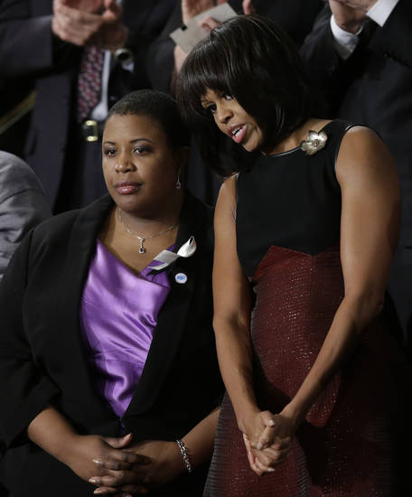 First lady Michelle Obama stands with Cleopatra Cowley-Pendelton before President Barack Obama's State of the Union address during a joint session of Congress on Capitol Hill in Washington, Tuesday Feb. 12, 2013. (AP Photo/Pablo Martinez Monsivais) ORG XMIT: CAP112