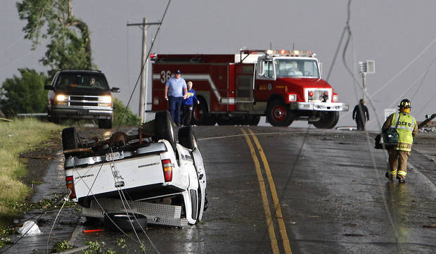 Power lines cross the road where a truck was flipped over after a tornado damaged the area around I-40 and Choctaw Road on Monday, May 10, 2010, in Oklahoma City, Okla.  Photo by Chris Landsberger, The Oklahoman