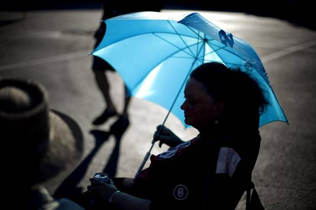 MUSIC FESTIVAL: Odalie Wildes takes shade under an umbrella during the first night of Jazz in June in Norman, Okla., Thursday, June 23, 2011. Photo by Bryan Terry, The Oklahoman ORG XMIT: KOD