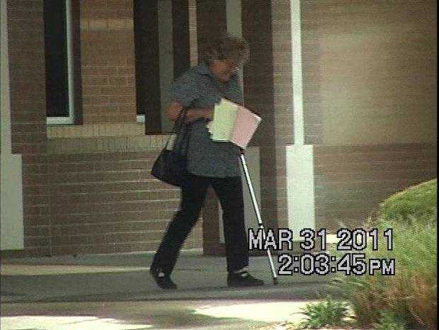 In these screen grabs from a private investigator�s 2011 video, Linda Lorrie Almy, right, is shown leaving a Tulsa doctor�s office with a cane, but then never using it the rest of the day. She is seen the same day walking into a casino, loading ice into her vehicle, fishing and building a bonfire by a creek.
