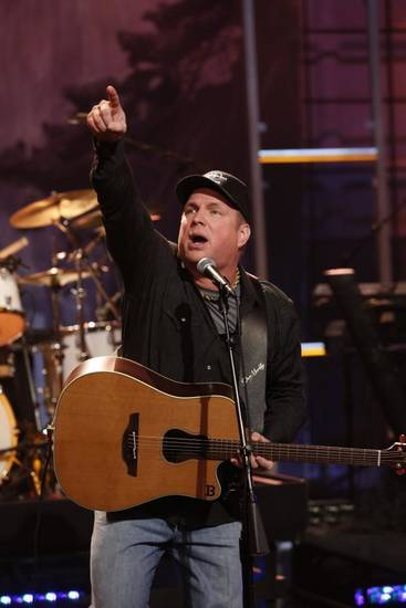 "musical guest Garth Brooks performs during Jay Leno's final episode of ""The Tonight Show,"" Thursday, Feb. 6, 2014, in Burbank, Calif. (NBC photo)"