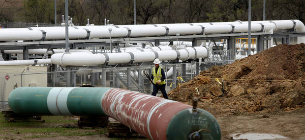 Large pipes for carrying crude oil are shown in a field near the TransCanada Corp. pipeline terminal on the south edge of Cushing. Photo by Jim Beckel, The Oklahoman <strong>Jim Beckel - THE OKLAHOMAN</strong>
