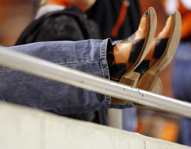 A Cowboy fan&#039;s boots during the college football game between Oklahoma State University (OSU) and the University of Colorado (CU) at Boone Pickens Stadium in Stillwater, Okla., Thursday, Nov. 19, 2009. OSU won, 31-28. Photo by Nate Billings, The Oklahoman
