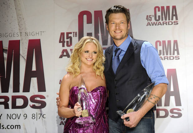 Tishomingo residents Miranda Lambert and Blake Shelton pose backstage with the awards for female vocalist of the year and male vocalist of the year at the 45th Annual CMA Awards in Nashville, Tenn., on Wednesday, Nov. 9, 2011. (AP Photo/Evan Agostini) <strong>Evan Agostini - AP</strong>