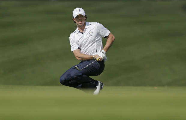 Europe's Rory McIlroy reacts after chipping up to the first green during a singles match at the Ryder Cup PGA golf tournament Sunday, Sept. 30, 2012, at the Medinah Country Club in Medinah, Ill. (AP Photo/Chris Carlson)  ORG XMIT: PGA115