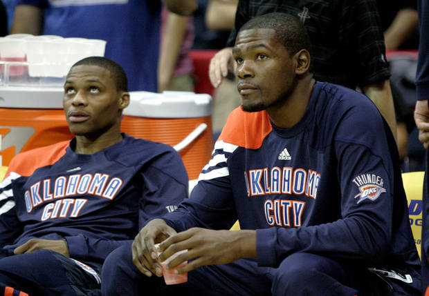 Oklahoma City Thunder's Russell Westbrook, left, and Kevin Durant wait before the start of an NBA preseason basketball game, Wednesday, Oct. 10, 2012, in Hidalgo, Texas. (AP Photo/Delcia Lopez) ORG XMIT: TXDL105