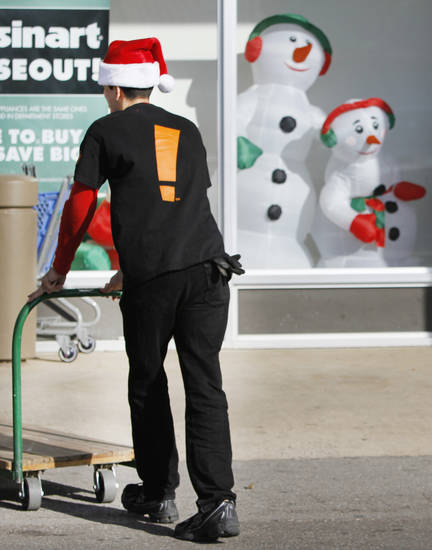 Ricardo Alejandro pushes a cart at Big Lots on South Pennsylvania in Oklahoma City, Thursday November, 24,  2011. Oklahoman Photo by Steve Gooch