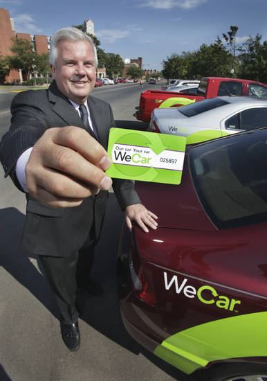 University of Oklahoma Transportation Director Doug Myers shows an electronic access card beside the Wecar rental cars on Tuesday, August 31, 2010, in Norman, Okla.  Photo by Steve Sisney, The Oklahoman