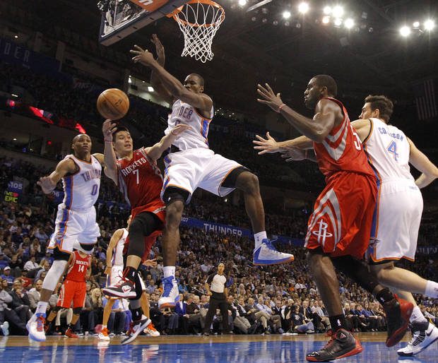 Oklahoma City 's Serge Ibaka (9) and Russell Westbrook (0) defend on Houston's Jeremy Lin (7) during the NBA basketball game between the Houston Rockets and the Oklahoma City Thunder at the Chesapeake Energy Arena on Wednesday, Nov. 28, 2012, in Oklahoma City, Okla.   Photo by Chris Landsberger, The Oklahoman