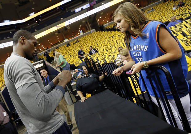 Oklahoma City's Serge Ibaka (9) signs an autograph for Thunder fan Maggie Turner of Cabot, Ark., before Game 4 of the second-round NBA basketball playoff series between the Oklahoma City Thunder and the Memphis Grizzlies at FedExForum in Memphis, Tenn., Monday, May 13, 2013. Photo by Nate Billings, The Oklahoman