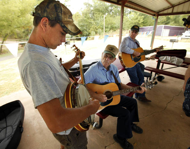 Sam Henderson, 17 from Doyle, joins a jam session at the Second Annual Bluegrass Festival on Saturday, Aug. 25, 2012, in Blanchard, Okla.  Photo by Steve Sisney, The Oklahoman