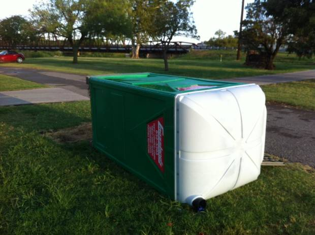 A portable rest room is blown over on E Overholser Drive on the northeast side of Lake Overholser. Photo by Robert Medley