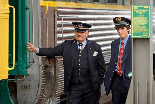 Assistant conductors Steve Davis, left, and son Michael Davis wait for passengers to start boarding for a train ride at the Oklahoma Railway Museum, 3400 NE Grand Blvd., in Oklahoma City, Saturday, April 7, 2012. The museum gives train rides the 1st and 3rd Saturday from April through August.  Photo by Nate Billings, The Oklahoman