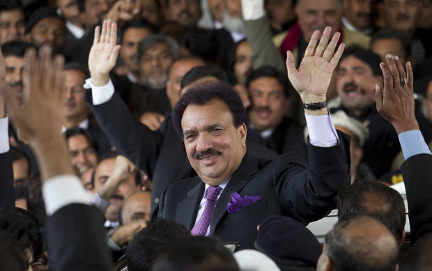 FILE - In this Thursday, Jan. 19, 2012 file photo, Pakistani interior minister Rehman Malik waves as he leaves the Supreme court in Islamabad, Pakistan. The court in recent months has targeted Pakistan�s interior minister, Rehman Malik, on the citizenship issue. Malik resigned his Senate seat, renounced his British citizenship and won his seat back in a special election, but the court is still looking at prosecuting him for allegedly not revealing his full status when he first held the seat. (AP Photo/B.K. Bangash, File)